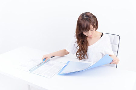 Young Japanese woman writing on white background Stok Fotoğraf