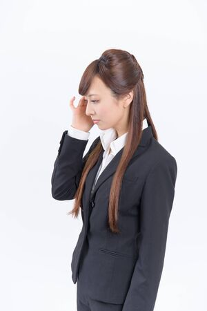 Japanese young woman with a headache holding head, isolated on white background