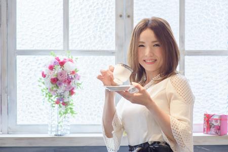One beautiful Japanese woman  to enjoy coffee