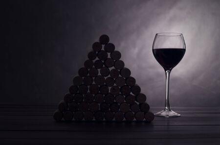 jams: glass with red wine near wine jams on a black  Stock Photo