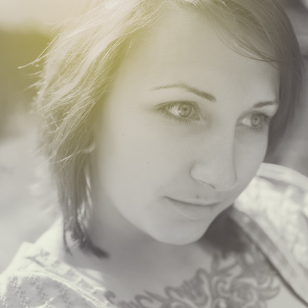 beautiful woman with a tattoo in vintage style outdoors photo