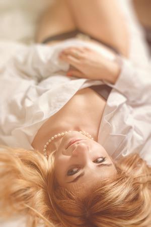 beautiful romantic nude woman in morning bed photo