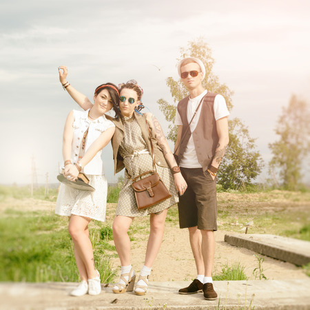 young active girls and guy hipsters of have fun outdoors summer photo