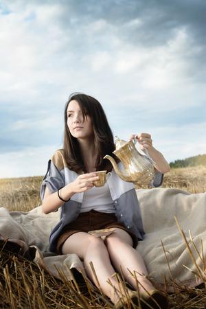 illustrates: young beautiful unusual girl illustrates conceptual idea in the field