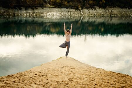 asanas: guy practices asanas on yoga in harmony with the nature