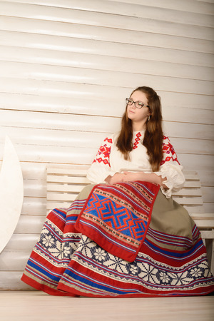 young woman in a Slavic Belarusian national original suit studio Stock Photo