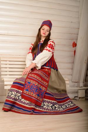 slavic: young woman in a Slavic Belarusian national original suit studio Stock Photo