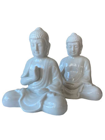 Ceramic buddha figurine isolated on white background. Traditional luck of east. Meditating and praying statue. Symbol of buddhism.