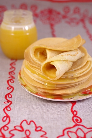 thin pancakes with honey on the table Stock Photo - 16776548