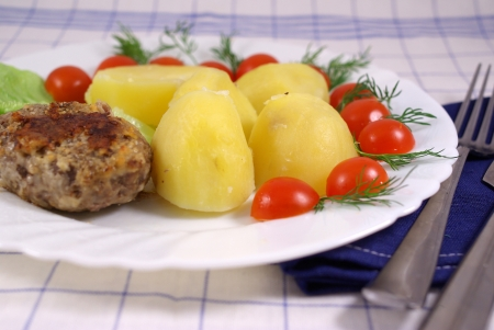Boiled potatoes with cutlet and vegetables Stock Photo - 16776110