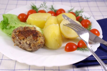 Boiled potatoes with cutlet and vegetables Stock Photo - 16776467