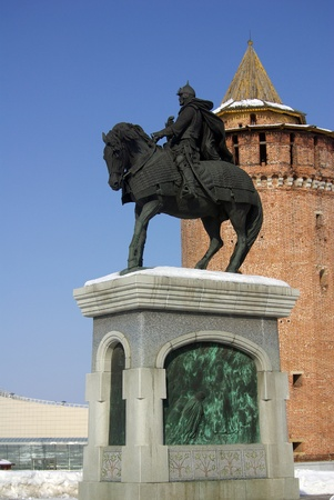 A monument to famous Russian historical figure Dmitry Donskoy and Kremlin tower in Kolomna, Russia.