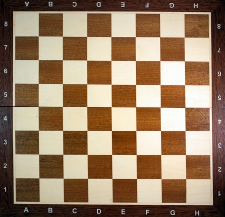 Empty wooden chess board, top view