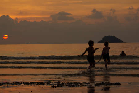 Sunset on the island of Koh Chang, Thailand photo