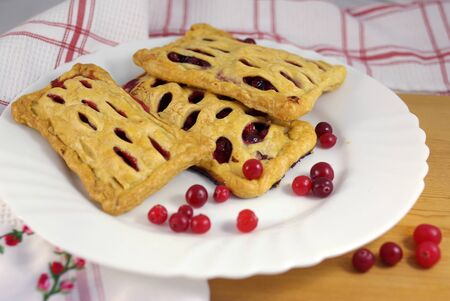 jam tarts: Cake with cranberries on decorated table on the plate Stock Photo