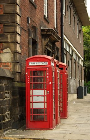 Traditional red telephone box in Leeds, UK