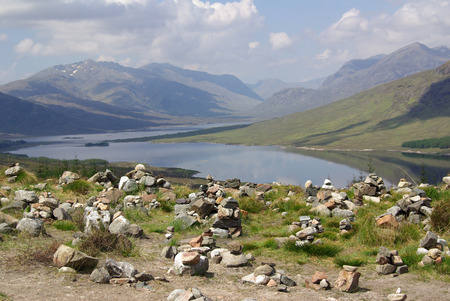 Shore of the lake in Highland in summer day, Scotland photo