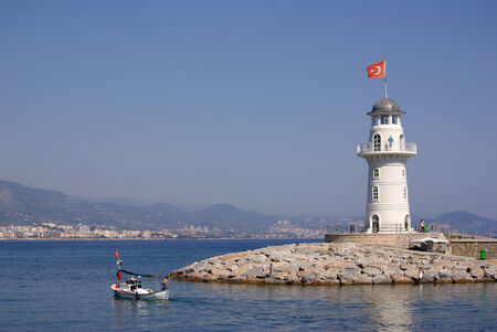 Lighthouse in Alanya in Turkey in summer day photo