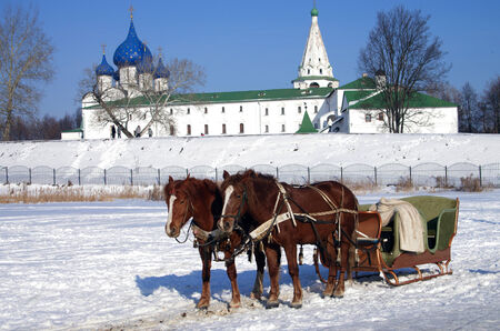 SUZDAL, RUSSIA - February 21, 2015: Horse carriage on the background of the Kremlin