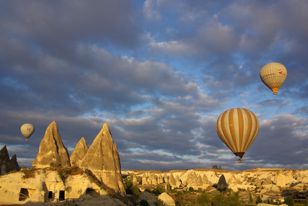 goreme: GOREME, TURKEY - June 13, 2014: Hot air balloon fly over Cappadocia in Goreme, Cappadocia, Turkey