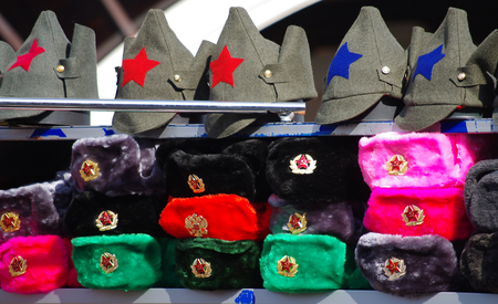 russian hat: Souvenirs with Russian symbols - winter army hat and soviet army cap Budenovka