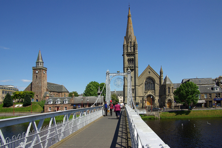ness river: INVERNESS, SCOTLAND - June 08, 2013: Bridge in Inverness, Scotland on a sunny summer day