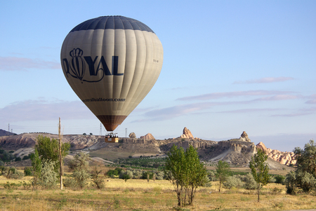 goreme: GOREME, TURKEY - June, 2014: Hot air balloon fly over Cappadocia in Goreme Editorial