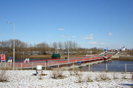 movable: KOLOMNA, RUSSA - April, 2014: Movable floating bridge through Moscow river in Kolomna town