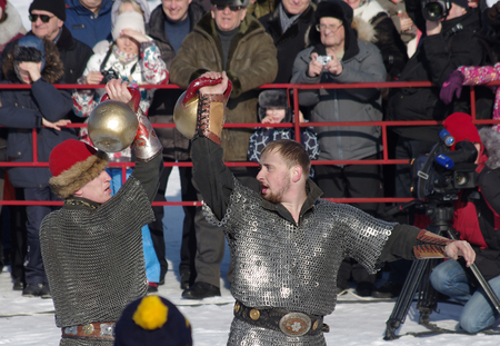 pancake week: SUZDAL, RUSSIA - February 21, 2015: Shrovetide in russia. Lifting weights at the festival. Maslenitsa or Pancake Week is the ancient Slavic Holiday Editorial