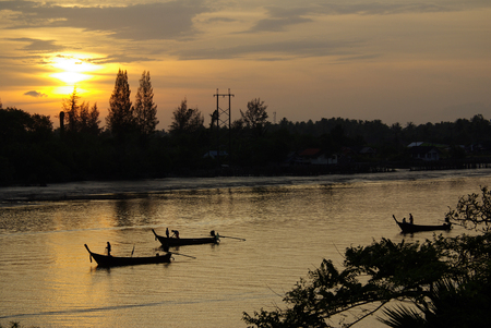 KRABI, THAILAND - January,  2014: Traditional Thai boat on the river Krabi in the early morning at dawn