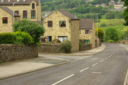 vibrant cottage: HAWORTH, ENGLAND - June, 2013: The village of Haworth in summer day