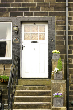 vibrant cottage: HAWORTH, ENGLAND - June, 2013: The house of the sister Bronte in the village of Haworth in summer day