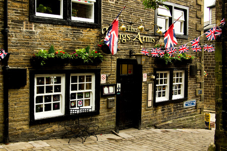 vibrant cottage: HAWORTH, ENGLAND - June, 2013: Souvenir shop in the village of Haworth in summer day