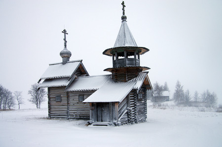 windstorm: KARELIA, KIZHI, RUSSIA - January, 2016: North Russian wooden architecture - open-air museum Kizhi, Karelia Editorial