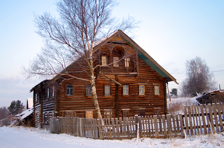 two storey house: KOSMOZERO, KARELIA, RUSSIA - January, 2016: Two-storey wooden house in the village of Karelia Editorial