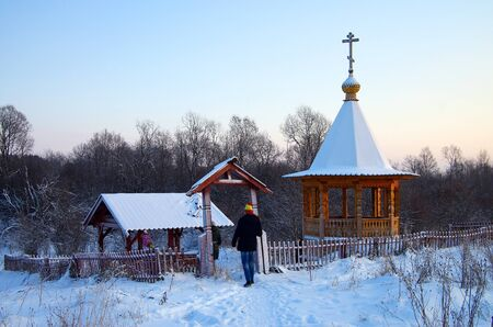december sunrise: KARELIA, RUSSIA - January, 2016:  Chapel with a source named Tsaritsyn key in Karelia