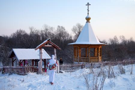 january sunrise: KARELIA, RUSSIA - January, 2016:  Chapel with a source named Tsaritsyn key in Karelia
