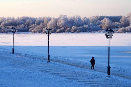 january sunrise: Lantern on the promenade in Veliky Novgorod, Russia