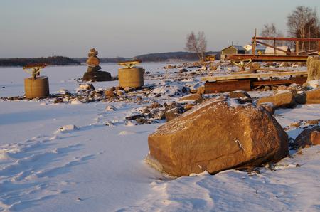 ladoga: Winter landscape in Karelia. Shore of lake Ladoga. Destroyed pier
