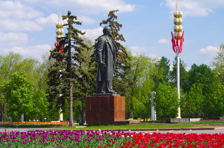 MOSCOW, RUSSIA - May 13, 2015: The All-Russian Exhibition Center in spring day, Lenin statue on the street Editorial