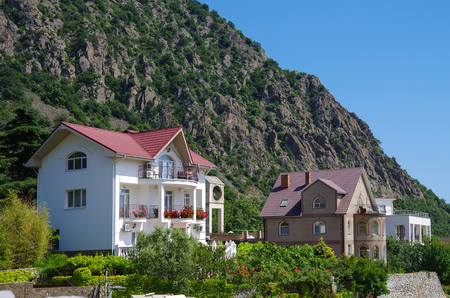 HURZUF, CRIMEA - June, 2018: View of the cottages in Gurzuf on the background of Ayu-Dag (Bear mountain)