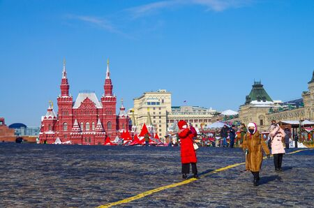MOSCOW, RUSSIA - February, 2018: Tourists take pictures of Moscow on Red square in the background of the State Historical Museum of Russia Editorial