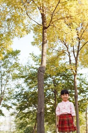 Little girl  wearing a plaid skirt