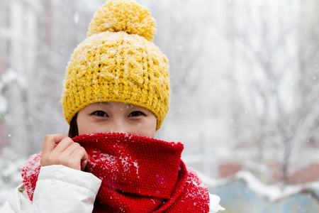 Girl wearing winter clothes Stock Photo