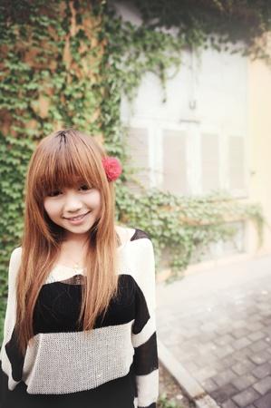 Asian girl in a garden Stock Photo