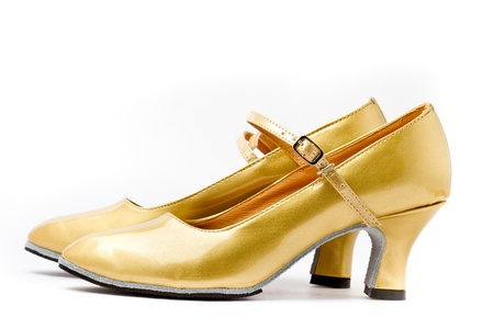 Gold high-heeled shoes Stock Photo