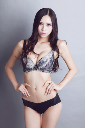 Sexy Chinese woman wearing bras Stock Photo