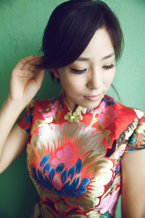 Asian beauty, dressed in traditional cheongsam