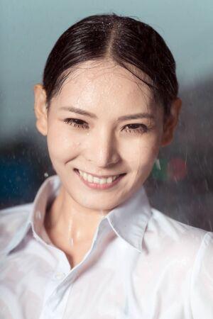 Beautiful asian woman portrait  in the rain