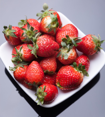 Strawberry, put in the white plate Stock Photo